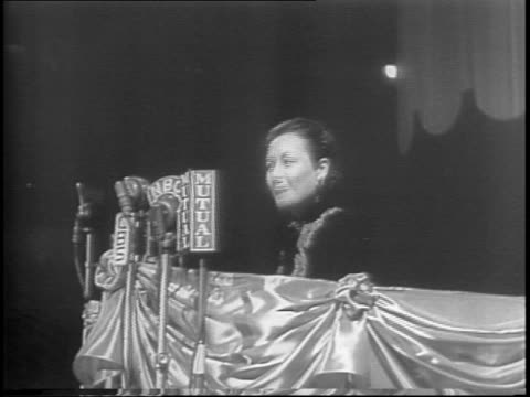 long shot of madison square garden / stage with seated dignitaries / view of audience members / long shot of audience / montage of chinese-american... - first lady stock videos & royalty-free footage