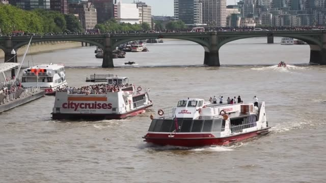 long shot of multiple city ferries, view from hungerford bridge. - hungerford bridge stock videos & royalty-free footage