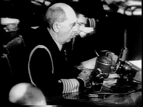 long shot of officials in senate caucus room / admiral william leahy speaking into microphone / admiral james otto richardson seated with audience... - witness stock videos & royalty-free footage