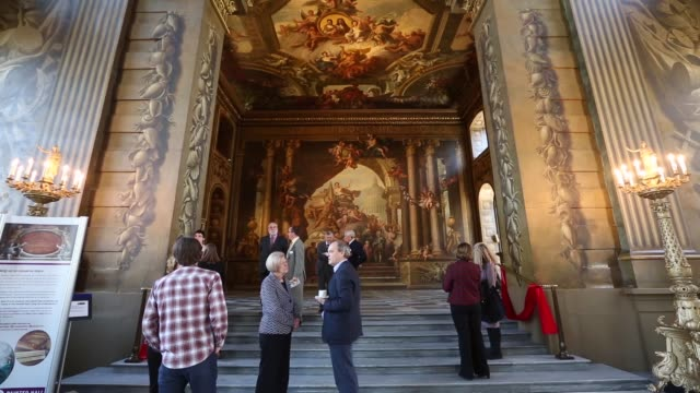 long shot of painted wall guests admire the west wall of the the old royal naval college's painted hall following its first restoration in 50 years... - royal navy college greenwich stock videos & royalty-free footage