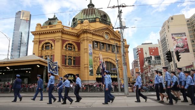 long shot of participants marching during the annual anzac day march outside of flinders street station. australians commemorate anzac day on april... - anzac day stock videos & royalty-free footage
