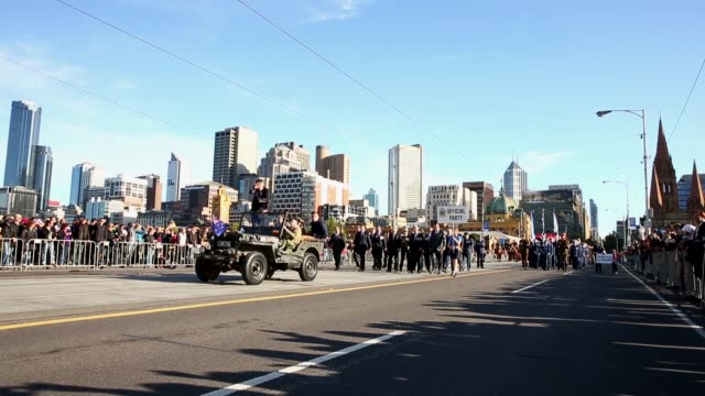long shot of passing parade, pan to left. long shot of passing parade, pan to left. on april 25, 2013 in various cities, australia - anzac day stock videos & royalty-free footage