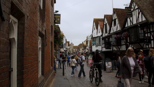 Long shot of people walking along Canterbury's High Street.