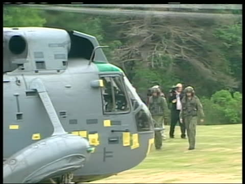 long shot of prince william approaching the sea king, a canadian navy helicopter capable of landing in water, before piloting it. the duke of... - (war or terrorism or election or government or illness or news event or speech or politics or politician or conflict or military or extreme weather or business or economy) and not usa stock videos & royalty-free footage