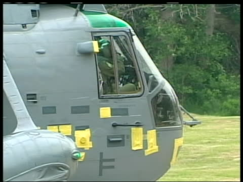 long shot of prince william preparing for takeoff in the sea king, a canadian navy helicopter capable of landing in water. the duke of cambridge flew... - (war or terrorism or election or government or illness or news event or speech or politics or politician or conflict or military or extreme weather or business or economy) and not usa stock videos & royalty-free footage