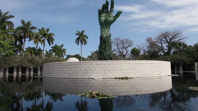long shot of 'reaching hand' statue at holocaust memorial long shot of 'reaching hand' statue at holocaust on april 08 2013 in miami beach florida - sculpture stock videos and b-roll footage