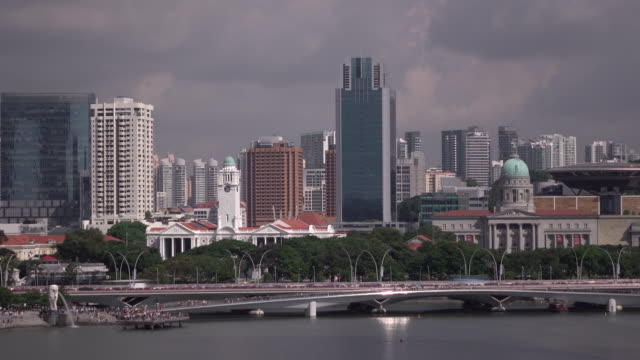 tl long shot of singapore skyline with merlion park and victoria concert hall as background - harbour stock videos & royalty-free footage