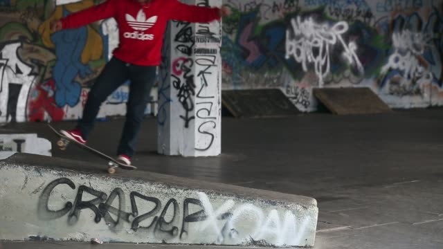 long shot of skater performing trick skateboarding's south bank home under threat at southbank centre on may 18 2013 in london england - skateboard park stock videos & royalty-free footage