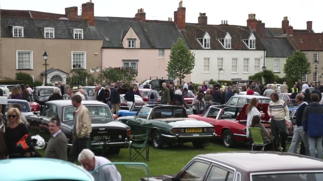 long shot of spectators gathering at watching classic cars. now in its 19th year and organized by the classic & historic motor club, this year's... - wells cathedral stock videos & royalty-free footage
