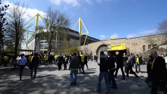 long shot of stadium and fans walking to watch the game signal iduna park general view at signal iduna park on april 20 2013 in dortmund federal... - borussia dortmund stock videos and b-roll footage