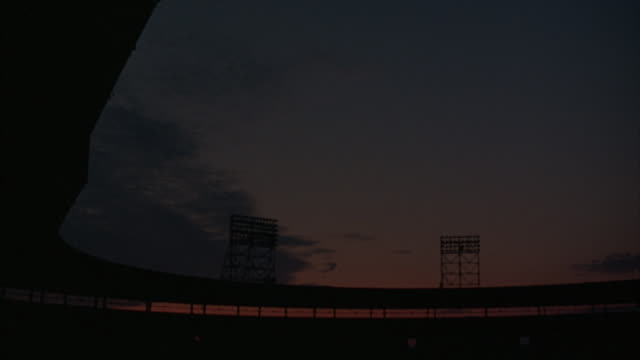 long shot of stadium lights turning on. - turning on or off stock videos & royalty-free footage