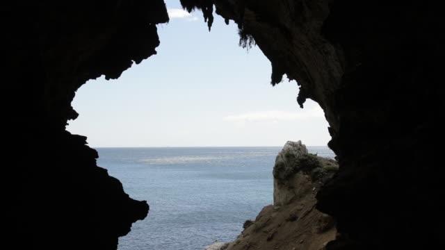 long shot of the alboram sea from the entrance of gorham's cave at the base of the rock of gibraltar. - gibraltar bildbanksvideor och videomaterial från bakom kulisserna