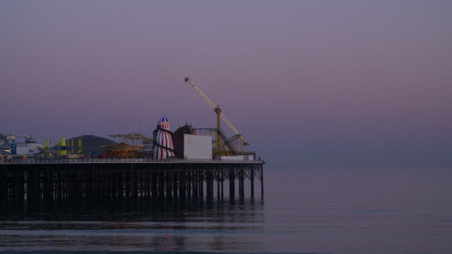 long shot of the amusement rides on brighton's palace pier. - brighton england stock videos and b-roll footage
