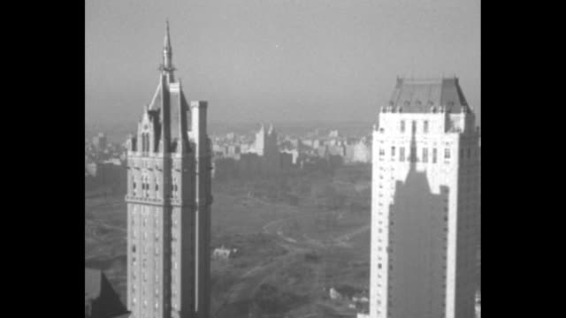 a long shot of the battery in manhattan with a ferry and tugboat passing / a pan of the skyline with buildings under construction / the view of lower... - passing a note stock videos & royalty-free footage