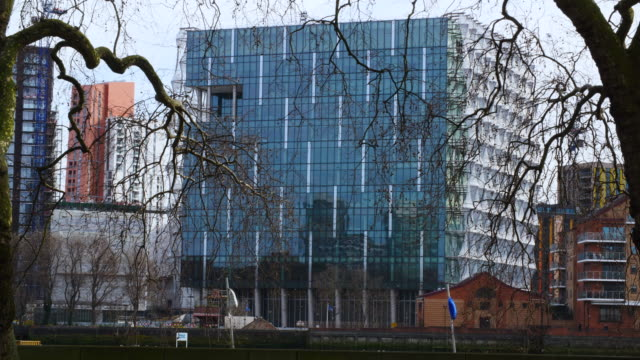 long shot of the exterior of the new us embassy at nine elms south london - fensterfront stock-videos und b-roll-filmmaterial