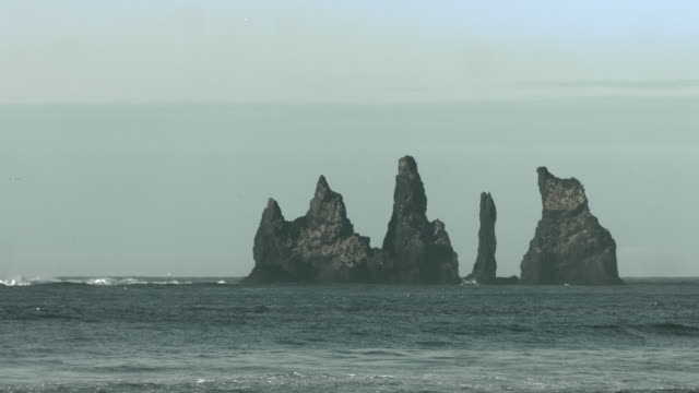 Long shot of the Reynisdrangar sea stacks in southern Iceland.