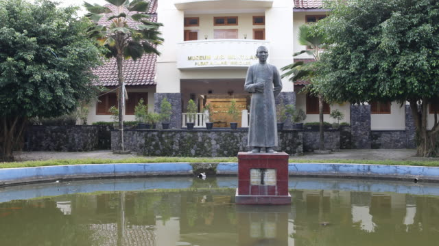 long shot of the sculpture of the famous dutch jesuit pater frans van lith sj in front of the museum misi muntilan pusat animasi misioner in muntilan... - jesuit stock videos and b-roll footage