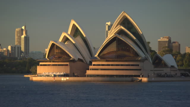 Long shot of the Sydney Opera House at dusk.