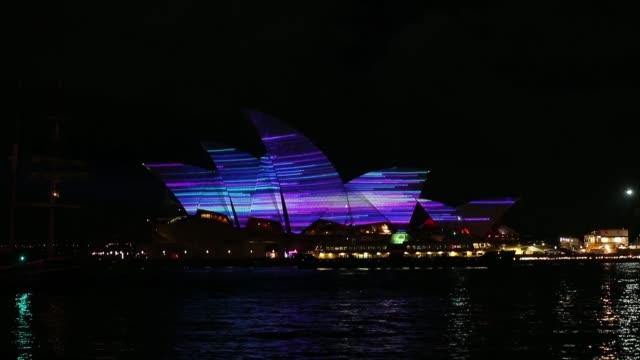 long shot of the sydney opera house illuminated vivid sydney opening night on may 24 2013 in sydney australia - bennelong point stock videos and b-roll footage