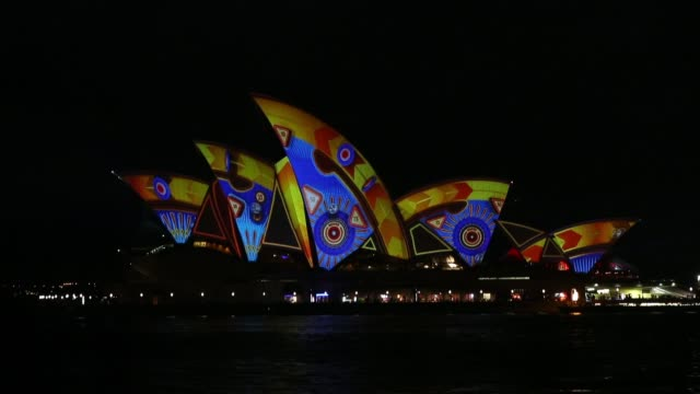 Long shot of the Sydney Opera House illuminated Vivid Sydney Opening Night on May 24 2013 in Sydney Australia