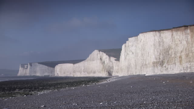 Long shot of the undulating Seven Sisters cliffs in East Sussex, UK.