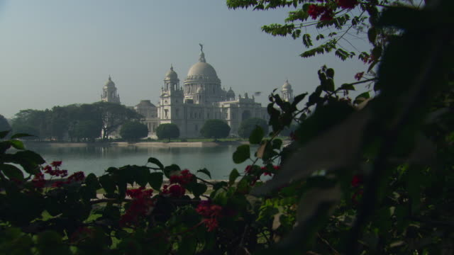 long shot of the victoria memorial hall in kolkata. - victoria memorial kolkata stock videos and b-roll footage