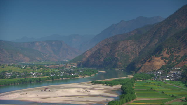 Long shot of the Yangtze River flowing through the Yunnan province of China.