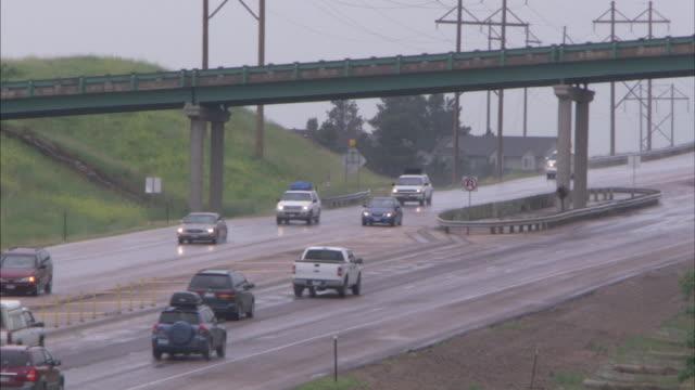 long shot of traffic travelling along a freeway near rapid city, south dakota. - rapid city stock videos & royalty-free footage