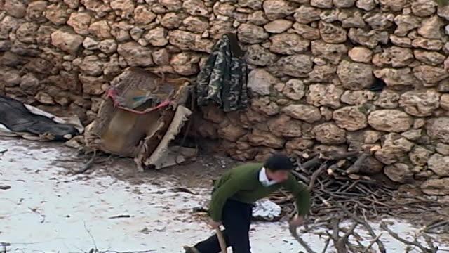 long shot of young man chopping wood from the kurdish village of kfarbe known in turkish as gungoren - chopping stock videos & royalty-free footage