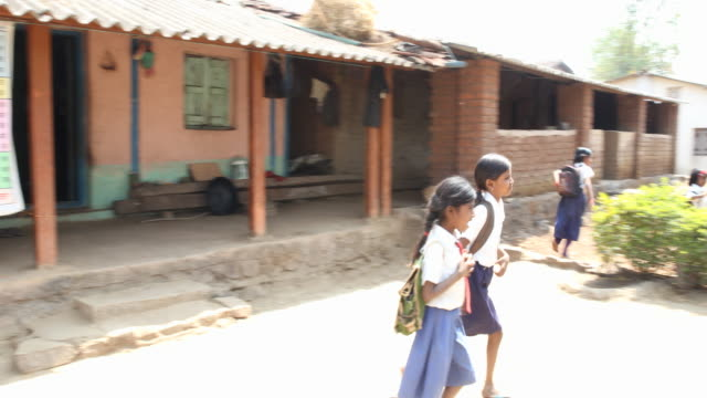 long shot on the pupils leaving the class room after the lesson with their teacher aside saying good bye the camera is following the pupils leaving... - primary school child stock videos & royalty-free footage