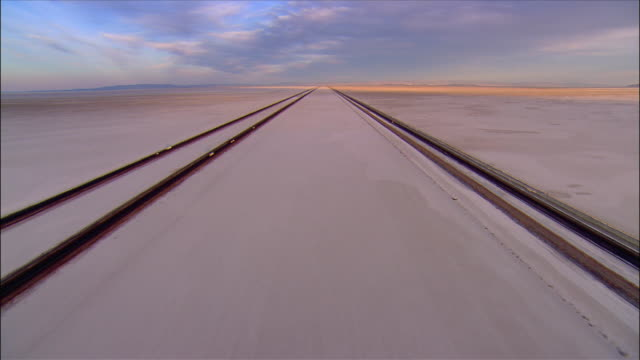 long shot over highway i-80 running across bonneville salt flats / utah - bonneville salt flats stock videos and b-roll footage