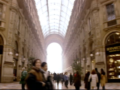 long shot panoramic view of the shoppers and stores in the arcade at galleria vittorio emanuele ii / milan, italy - mcdonald's stock videos and b-roll footage