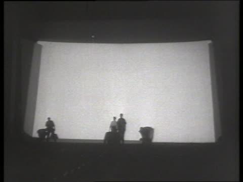 long shot people by new wide movie screen / 1950's / no sound - biosalong bildbanksvideor och videomaterial från bakom kulisserna