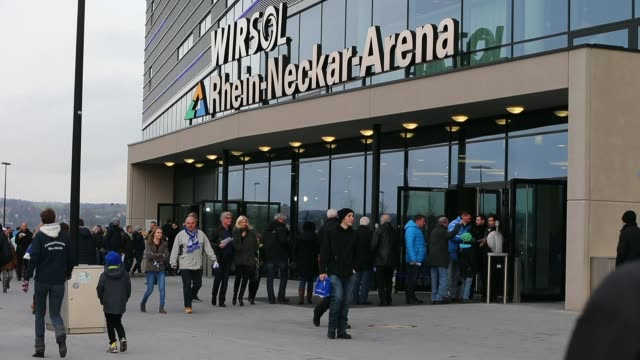 long shot, people gather in front of the stadium ahead of the match. general views of the wirsol rhein neckar arena prior to the bundesliga match... - 1899 stock videos & royalty-free footage