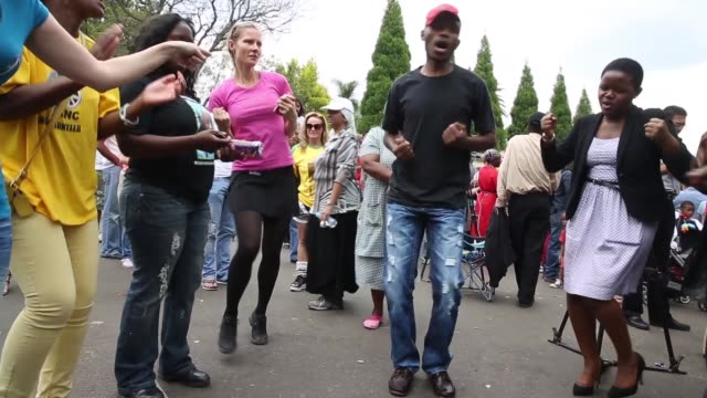long shot people sing and dance on the street of johannesburg in celebration of nelson mandela's life in south africa on december 9 2013 - multiculturalism stock videos & royalty-free footage