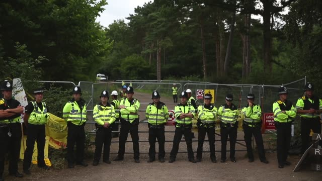 long shot, police cordon in front of fracking site entrance. protesters gather outside a drill site operated by cuadrilla resources ltd on august 19,... - west sussex stock videos & royalty-free footage