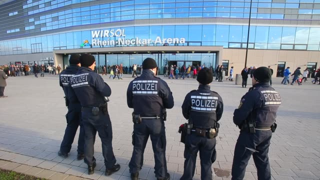 long shot, police officers in front of stadium. general views of the wirsol rhein neckar arena prior to the bundesliga match between 1899 hoffenheim... - 1899 stock videos & royalty-free footage
