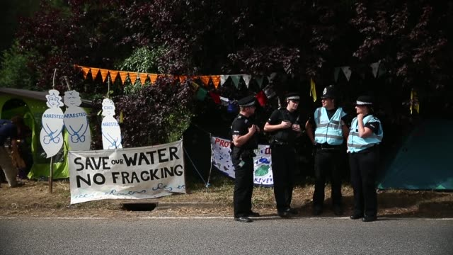 long shot, police officers standing next to the protestors' camp. protesters gather outside a drill site operated by cuadrilla resources ltd on... - west sussex stock videos & royalty-free footage