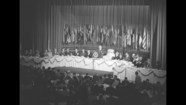 long shot pres harry s truman at lectern at head table during convention of the columbia scholastic press association vips and audience give standing... - hands behind head stock videos & royalty-free footage