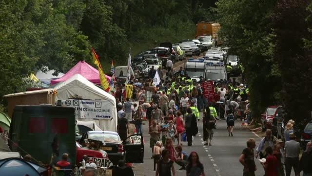 long shot, protesters gather outside a drill site operated by cuadrilla resources ltd on august 19, 2013 in balcombe, west sussex. protesters... - west sussex stock videos & royalty-free footage