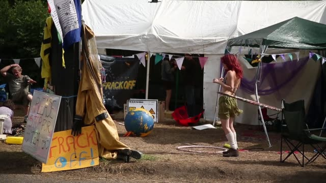 long shot, protestor playing hula hoop at camp. protesters gather outside a drill site operated by cuadrilla resources ltd on august 19, 2013 in... - west sussex stock videos & royalty-free footage