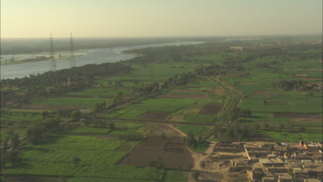 long shot, push-in - the river nile supplies the nile delta with water for agriculture and living / egypt - irrigation equipment stock videos & royalty-free footage
