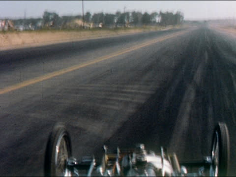 1959 long shot race car point of view speeding along track at raceway - 1950 1959 stock videos & royalty-free footage