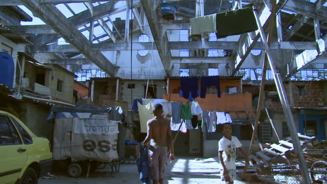 Long Shot residents gather in a formerly deserted building which is currently home to 82 families who occupy the building in the port district on...