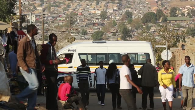 long shot residents of diepsloot township go about their daily activities as they pass the public holiday following youth day on june 17 2013 in... - soweto stock videos & royalty-free footage