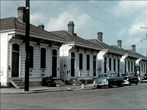 1956 long shot row of renovated houses - doppelhaus stock-videos und b-roll-filmmaterial