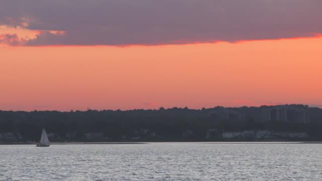 long shot sea coast and sailboat crossing - ニューヘイブン点の映像素材/bロール