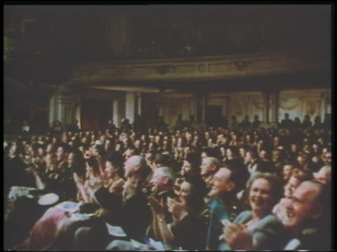 1943 long shot seated audience clapping in theater - audience stock videos & royalty-free footage