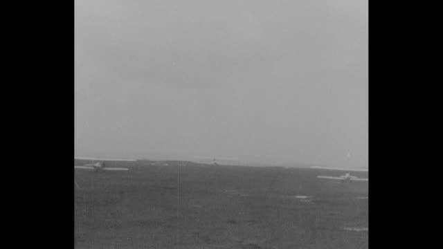 long shot several planes take off from the training camp as trainees prepare for wwi duty / planes fly low and start to ascend / planes fly in the... - allied forces stock videos and b-roll footage