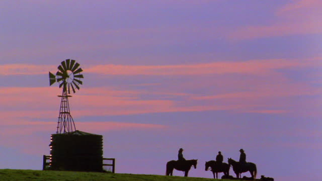 long shot silhouetted cowboys on horseback - mill stock videos & royalty-free footage